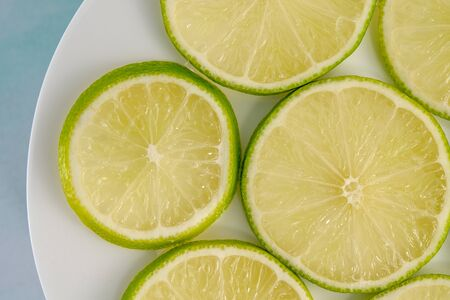 Lime Sliced on a Plate, Top View Close Up Banco de Imagens