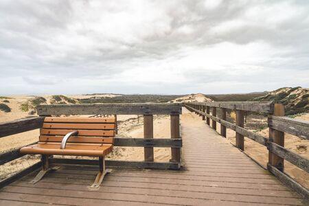Rustic Wood Beach Boardwalk Through Sand Dunes. Oso Flaco Lake Natural Area State Park, California