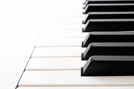 Piano Keyboard close up on white background with copy space