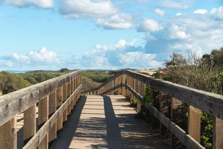 Wooden Boardwalk through the Dunes. Oso Flaco Lake Natural Area, Oceano, California