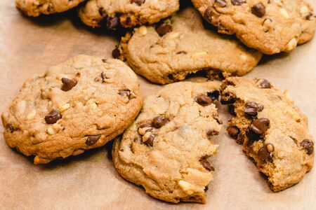 Chocolate chip cookies with pine nuts. Homemade old-fashioned Chocolate Chip Cookies close up. American cuisine, dessert