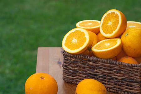 Basket of fresh ripe organic oranges close up in a garden Stockfoto