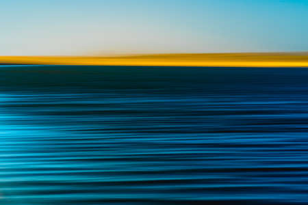 Sand dunes and blue river abstract background. Motion blur, Creative line art in cyan, dark blue, turquoise, and yellow colors.