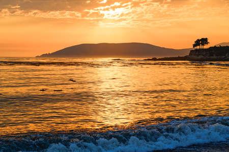 Sunset over the sea. Beautiful scenic seascape, tropical beach background