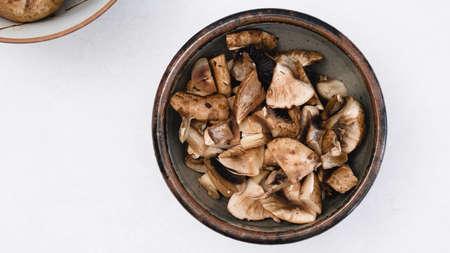 Freah raw chopped mushrooms close up in a bowl , flat lay with copy space Zdjęcie Seryjne