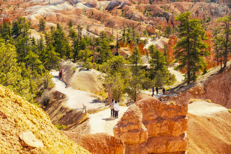 Bryce Canyon National Park hiking trail, Utah. Aerial view Bryce Canyon valley with walking tourists Stock Photo