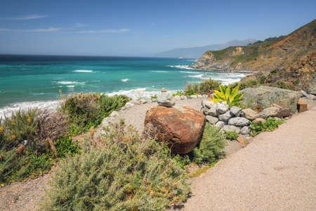 Big Sur, Monterey Conty, California.  Pacific Ocean, cliffs, and native plants on the beach