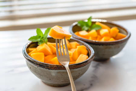 Melon salad with mint leaves close up in a bowl , selective focus Stock Photo