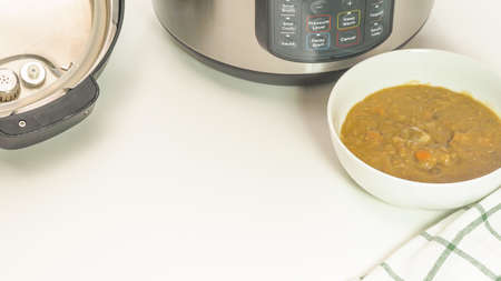 Creamy lentil soup cooked in multi cooker close up in a bowl on white background with copy space Stock Photo