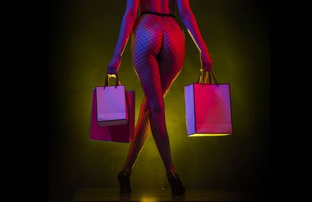 Sexy shopping. Intimate purchases. Gifts from the ass. Woman, rear view. Buttocks.