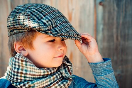 Preschool child. Boy face. Elegant child. Autumn weather. People, adorable kid, funny portrait. Cap hat and scarf.