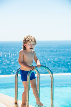 Happy kid. Pool. Summer lifestyle. A child near the pool. Resort near the sea.