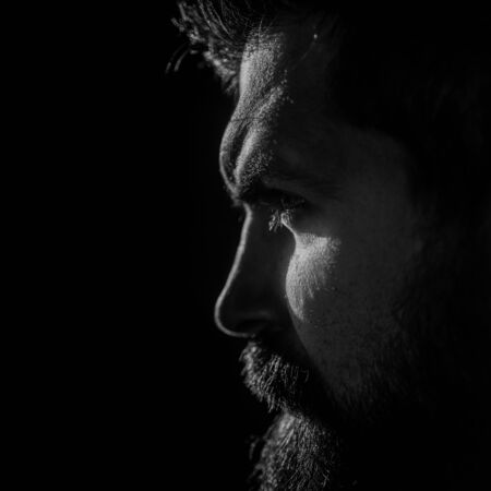 Man portrait. Real man. Emotional face. Guy with beard. Black and white photo with a portrait. Reklamní fotografie - 129177208