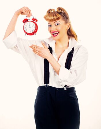 Girl with an alarm clock. Happy girl holds a vintage watch. Time concept. Happy adult. Banque d'images - 131765667