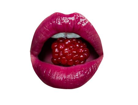 Raspberries in mouth. Female lips and teeth lick eat red tasty raspberries. Diet berries, passionate blowjob concept, oral sex. Open girl mouth with dessert. Lips with pink lipstick isolated.