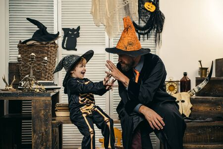 Father and son for Halloween. Happy autumn holiday. Halloween party costumes. Family fun. Game and play.