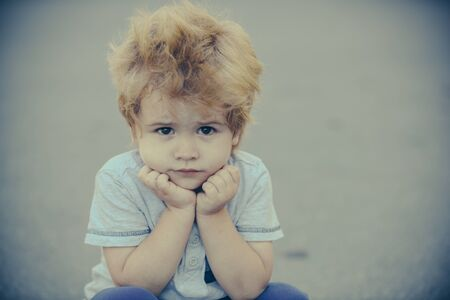 Sad boy. Beautiful child. Frustration and melancholy. Childrens emotions. Stockfoto
