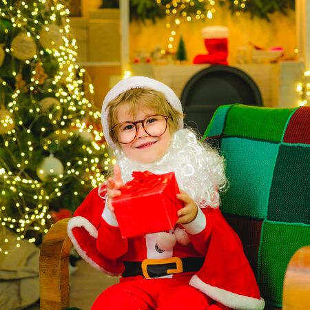 Santa Claus. A child with a New Year gift. Christmas surprise. Family concept. Holidays.