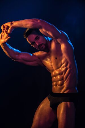 Exercises. Gym. A perfect body coach. Beautiful male body. Sports muscles. Sexy guy.