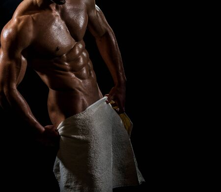 Man after a shower. Beautiful male body. Sports muscles. Sexy guy. White towel for a guy.