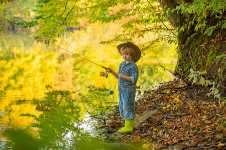 Beautiful boy fishing in the forest. Forest lake and fishing.