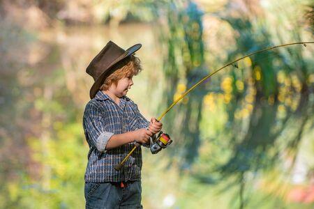 Big fish. Catch. Boy fisherman caught a big fish. Surprise Banco de Imagens