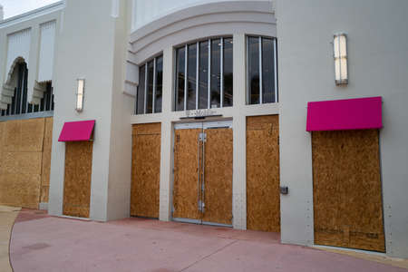 Miami Beach, FL, USA - JUNE 7, 2020: T-mobile brand store protect storefronts from burglars during nationwide protests in USA