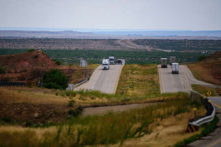 Trucks in the mountains of Arizona and New Mexico. US trucks. Delivery of goods, the US domestic market. Route, highway.