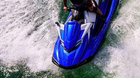 Speed on the ocean. Jetski. Beautiful sport on ocean waves. Tourist on a jet ski. Rest on the ocean. Summer vacation.