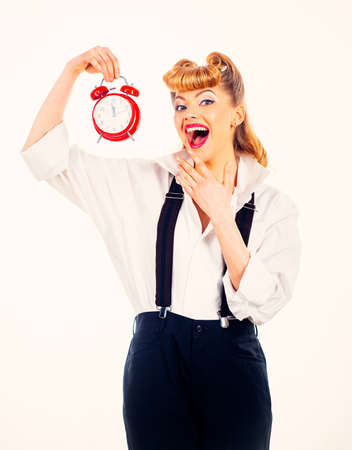 Happy woman and time management concept. Blogger with a clock. Woman on a white background.