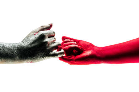 Different people came to firt peace after argument. Gentle and ceraful touch with little finger. Concept of little peace, of two people which came to reconciling. Symbolistic photo of war and peace.