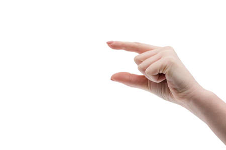 Something small. The gesture shows a little thing. Female hand and size. Banque d'images