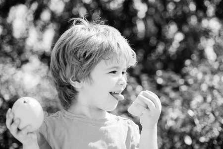 Boy and lemon. Citrus against viruses. Happy baby and coronavirus prevention.