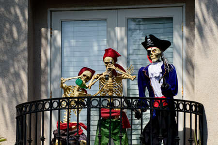 Skeletons pirates on the balcony at home. Halloween scenery. Terrible holiday at home. Halloween in the USA. Traditions and house decor. Terrible creatures.