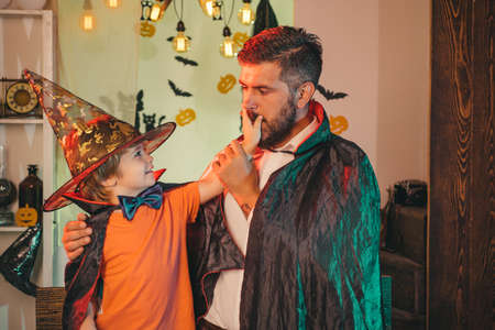 Scary night. Secret. Father and son in costumes for Halloween party.