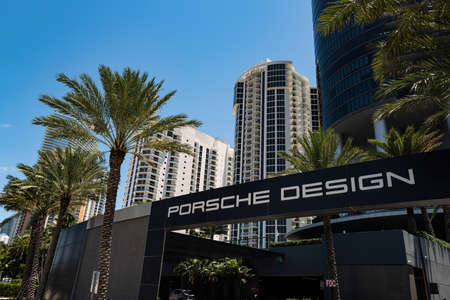 SUNNY ISLES BEACH, USA - MAY, 2020: Porshe design condominium sign. Porsche skyscraper. Unique buiding.