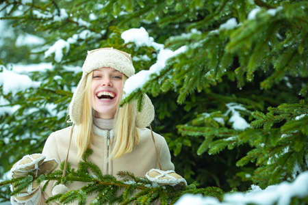 Happy girl in winter forest.