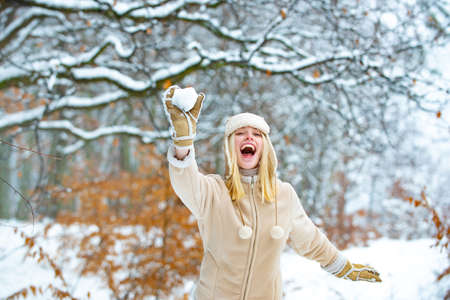 Happy winter game. Woman with snow.