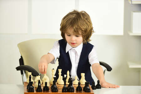 Quarantine Games. Chess. Boy and a chessboard.