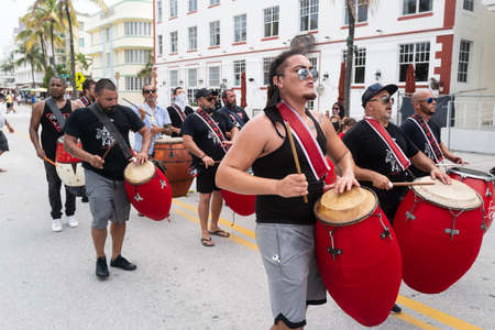 Miami Beach, FL, USA - JULY, 2020: Street musicians in Miami. Festival. Walking with musical instruments.