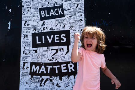 Strong happy child and Black lives matter poster. 免版税图像