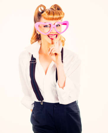 Happy young woman with heart glasses. Valentines Day.