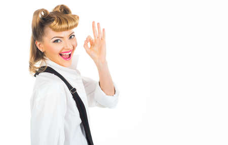 Happy young woman showing fingers sign ok. High quality score.