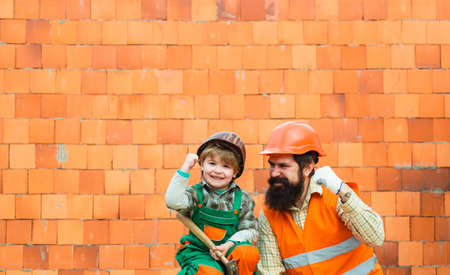 Cooperation. Happy colleagues. Builders at the workplace. Father and son are building a new house together. Family matters. Future profession job. Dynasty.