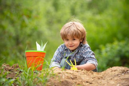 Happy kid in the garden. Spring farm mood.