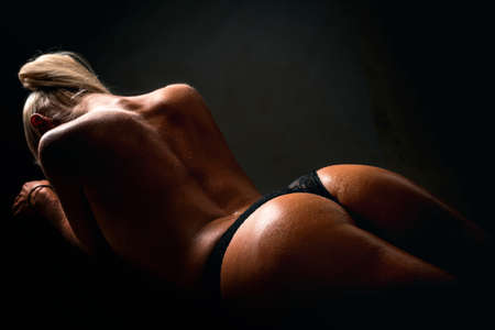 Woman in lingerie. Black color underwear. Sexy girl. 免版税图像