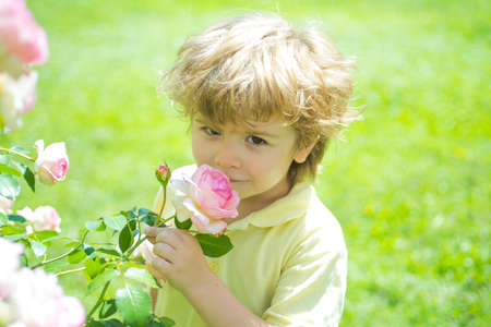 Kid and rose. Children with nature concept.