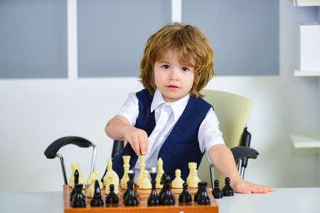 Chess. Kid player, smart boy. Logical thinking.