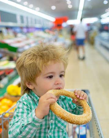 Shopping with child. Supermarket snack. Cute boy.