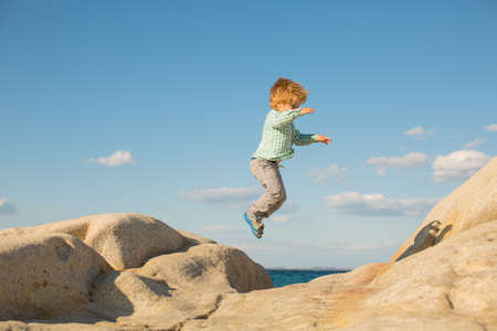 Happy jump. Children holidays at the beach.